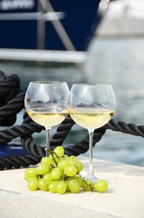 Wine and grapes at the yacht pier
