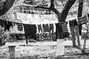 Launder clothes drying on a rope in the street