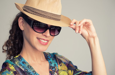 young stylish woman wearing hat and sunglasses