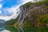 Fototapety Waterfall in Geiranger fjord Norway