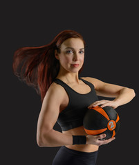 Sport woman with a ball in his hands