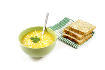 Pumpkin soup with grated cheese and sliced bread
