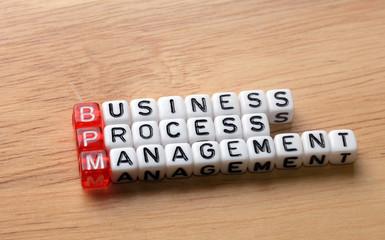 BPM  business process management on wood