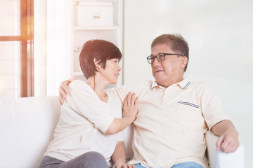 Asian senior couple at home