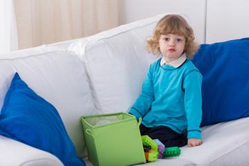 Cute preschooler on the sofa