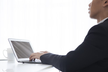 Men are using a notebook computer