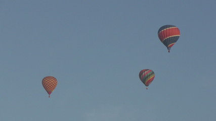 Colorful hot air balloons in 4K against hazy sky