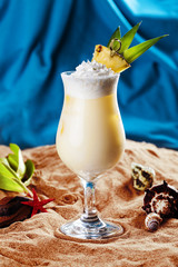 beautiful milk cocktail with slice of pineapple on a beach in