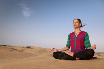 Young female practising yoga meditation in Jaisalmer, India