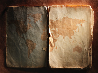 world map displayed on the spread of vintage books
