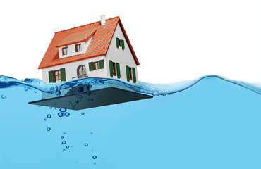 Toy house sinking underwater on a white background
