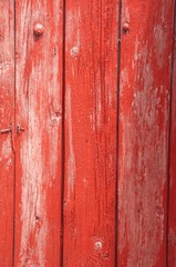 Red wooden fence made of the boards
