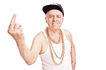 Senior man in hip-hop clothes, giving the finger