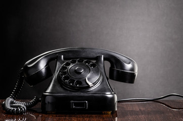 Old black telephone retro 1970s style with Copy-space