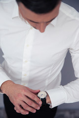 Businessman looking on wristwatch
