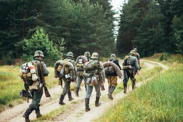 Unidentified reenactors dressed as German soldiers during march