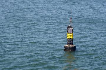 autonomous buoy with solar panels on  water