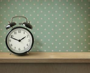 Alarm clock on table or shelf background