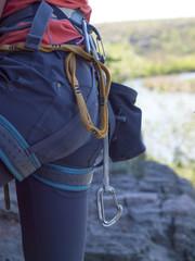 Rock climbing equipment weighs on the girl.
