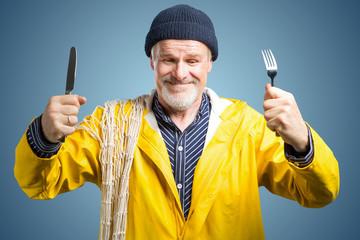 Hungriger seeman mit Messer und Gabel in der hand