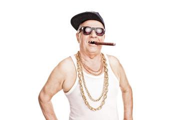 Toothless senior with a hip-hop cap smoking cigar