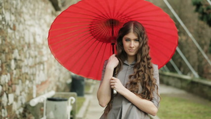 Elegant Fashion Model With Long Hair Poses With Traditional Japanese Umbrella