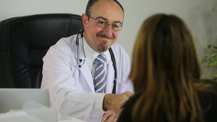 Doctor talking with a female patient
