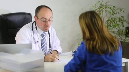 Doctor explaining a prescription to a female patient