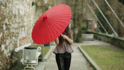 Beautiful Fashion Model Hides Behind Traditional Japanese Handmade Red Umbrella