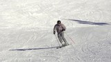 Slow Motion Wide Shot Of Skier Skiing Down The Ski Track During Winter Holidays