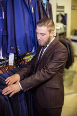 young man chooses suit