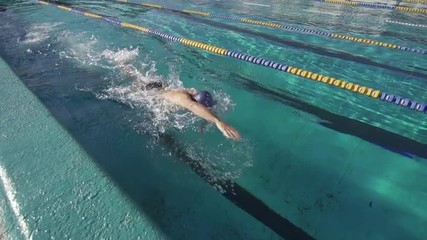 Slow Motion Of A Professional Swimmer Performing The Front Crawl Stroke