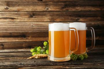 Mug of beer on a brown wooden background