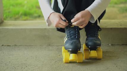 Woman Ties Roler Skates Shoe Laces