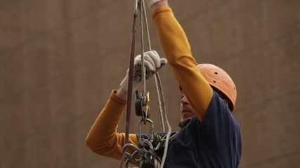 Industrial climber climbing rope. Mountaineering gear