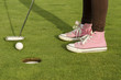 Hit with golf club of a young girl