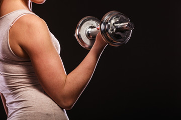 athletic woman working with heavy dumbbells