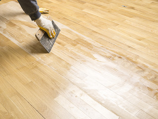 Varnishing parquet floor with space for your text.