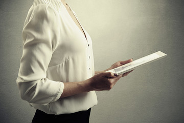 woman holding tablet pc with graphic