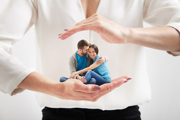 woman's hands holding small couple