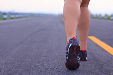 Stock Photo - athlete running sport feet on trail healthy lifest