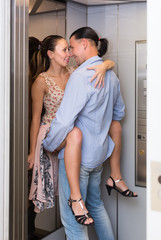 Adult couple having sex at elevator