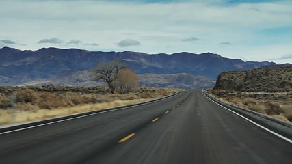 Cinematic road trip travels down a barren and desolate.