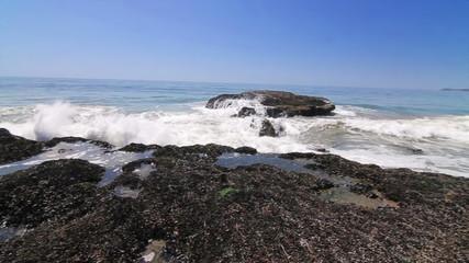 Surf's Up Malibu. Camera pans back and forth as waves crash.