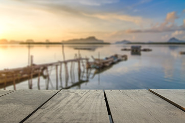 Defocused and blur image of terrace wood and beautiful seascape