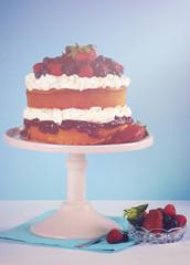 Fresh whipped cream and berries layer sponge cake.
