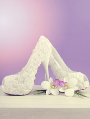 Wedding Bridal concept with white floral high heel shoe and flow
