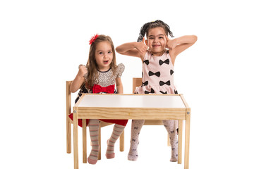 Two girls making funny faces and gestures