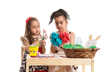 Creative girls making easter decorations