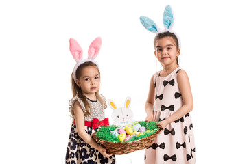 Sisters with bunny ears holding basket